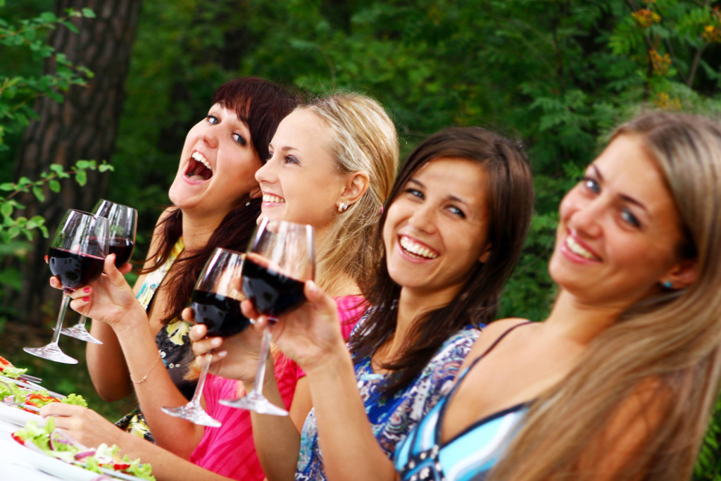 group of beautiful girls drinking wine